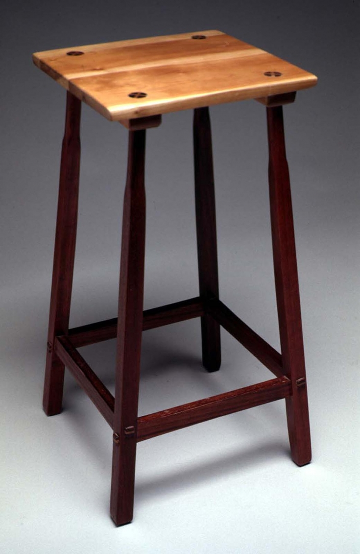 "Splay leg thin-top stool, 1999, 25"" high, Padauk wood with cherry wood seat, lacquer finish, collection of the artist (photo: Al Surratt)"